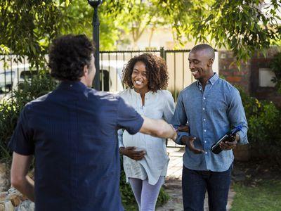 Young couple greeting man during visit at yard
