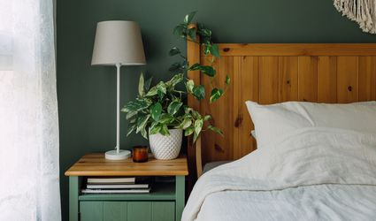 Smokey green wall paint in a bedroom