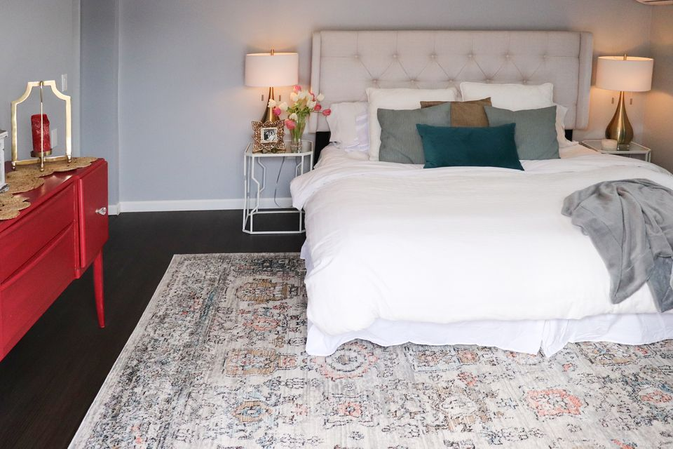 The Spruce Home Summer Area Rug in a Bedroom