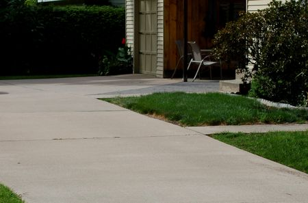 What to know about sealing concrete driveways and patios image of a concrete driveway solutioingenieria Image collections