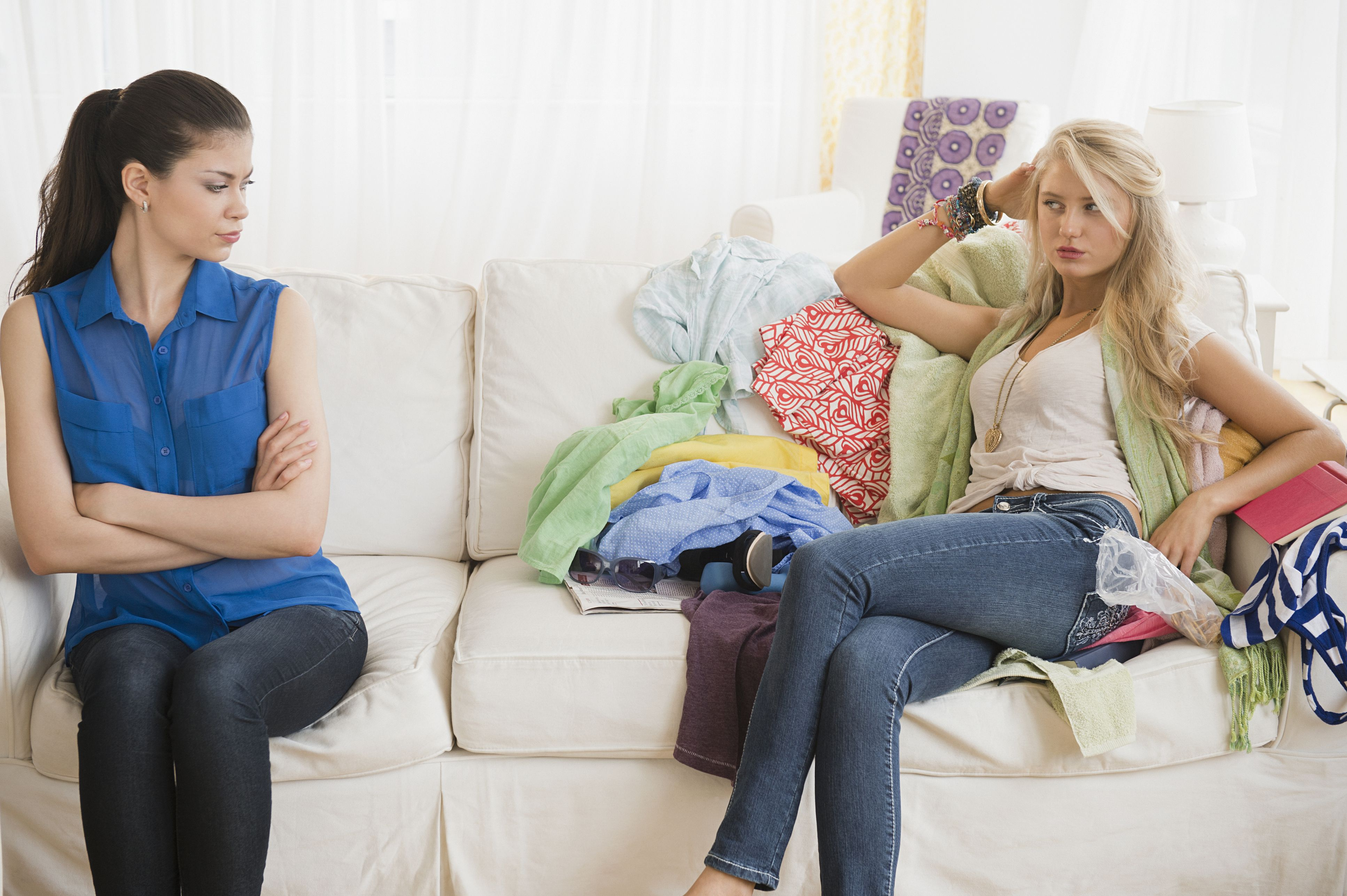 Neat woman unhappy with a messy roommate