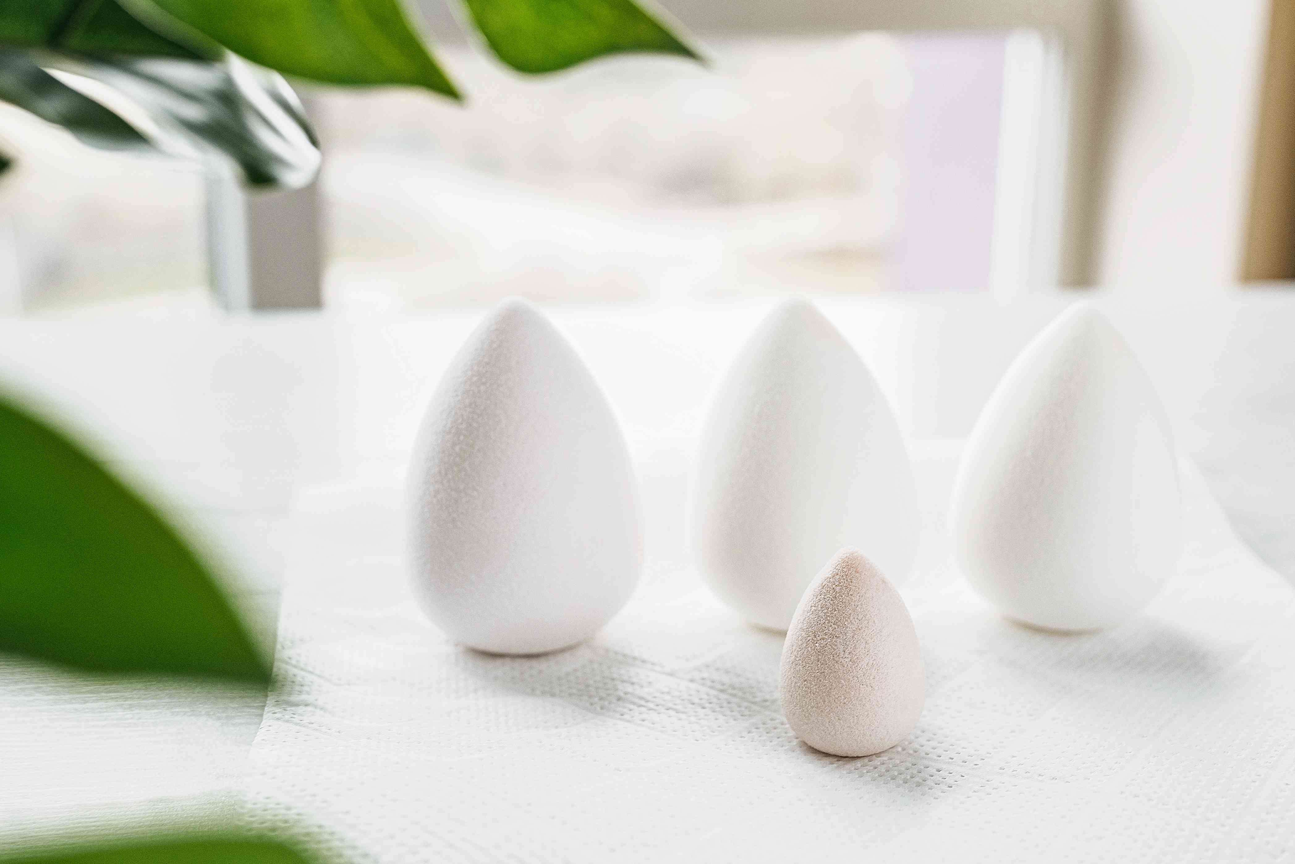 Cleaned beauty blenders sitting on paper towel for air drying