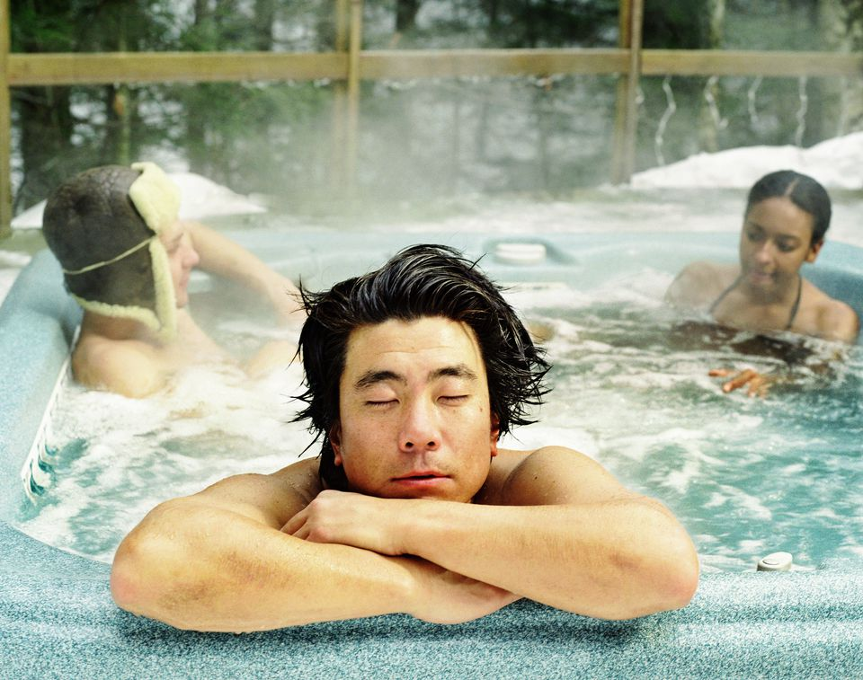 people in hot tub in snow