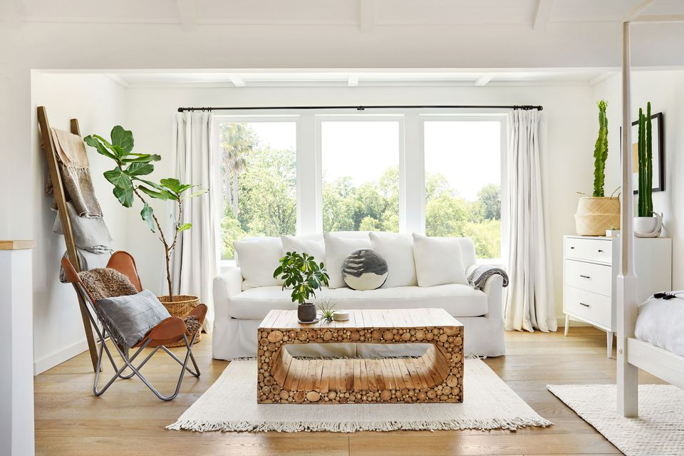 Light and airy white living room with plants