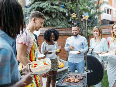 Neighbors enjoying a backyard party