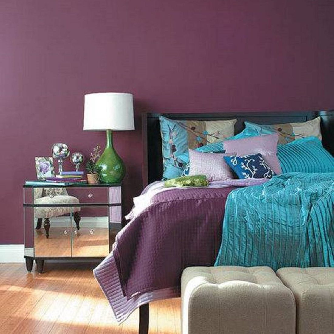 Purple walls in a sophisticated bedroom.
