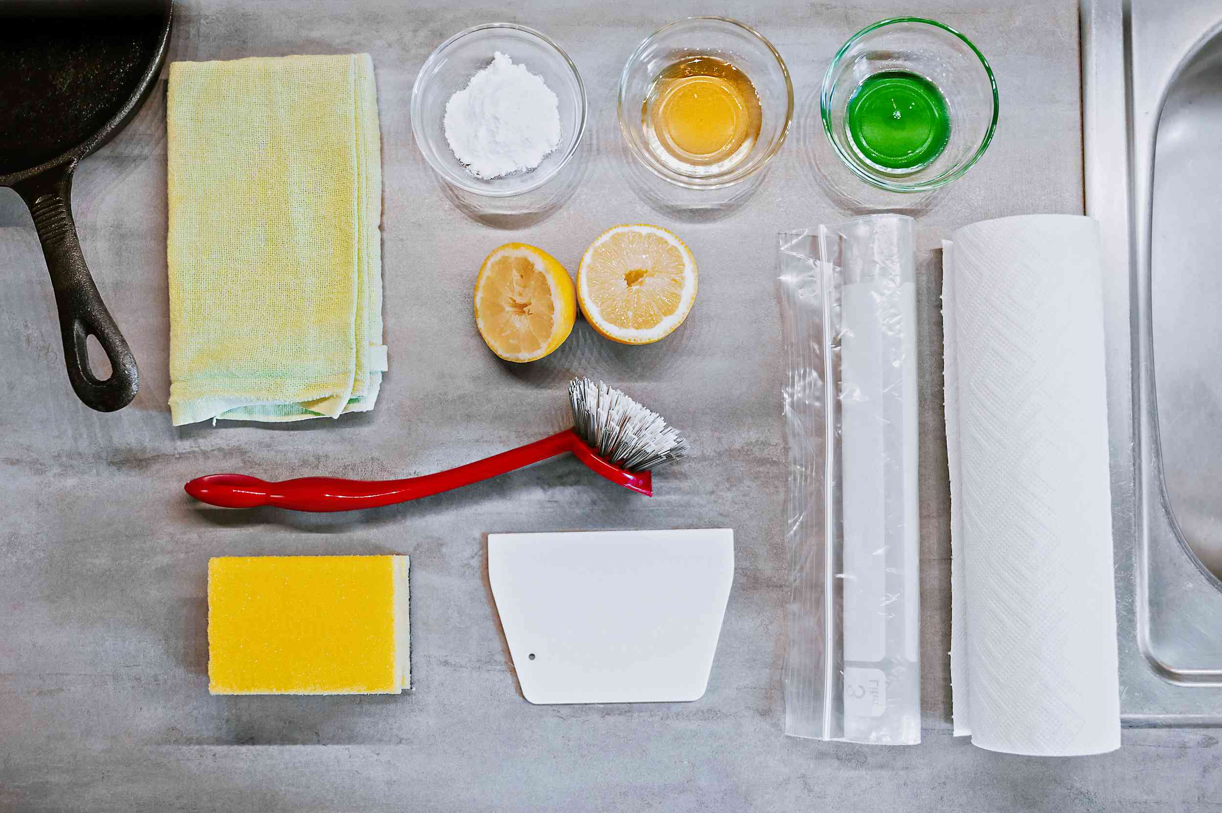 Materials and tools to clean a cast iron griddle pan