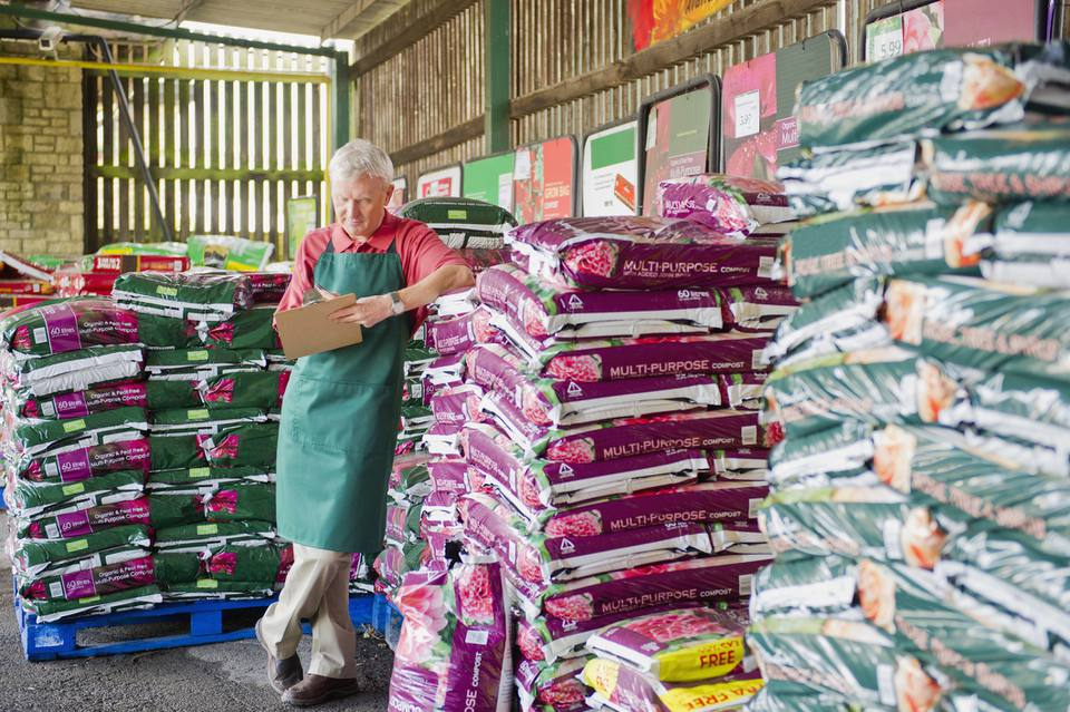 Man next to fertilizer in a garden center