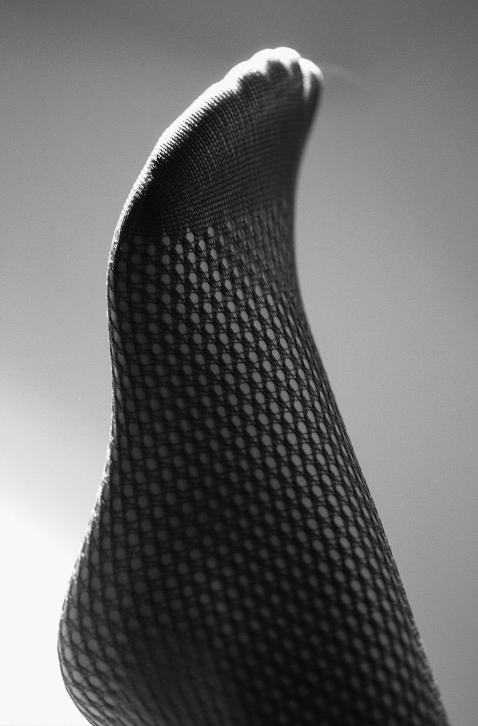 A single visible nylon stocking on a foot