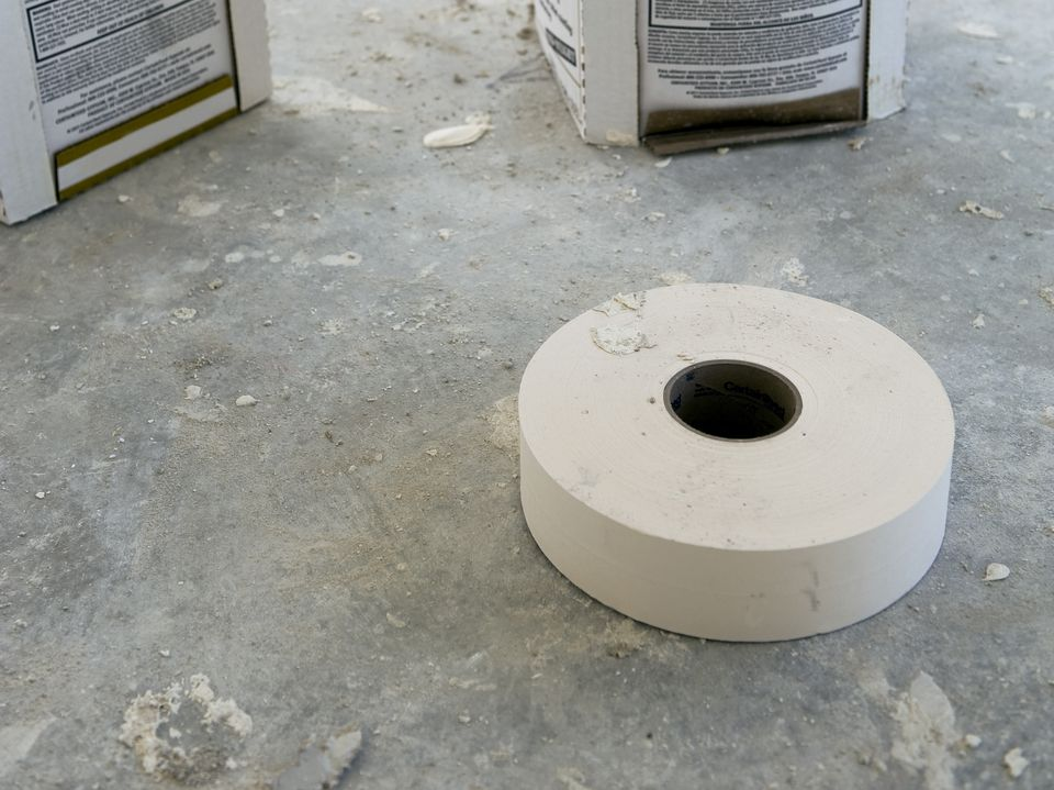 A roll of paper drywall tape