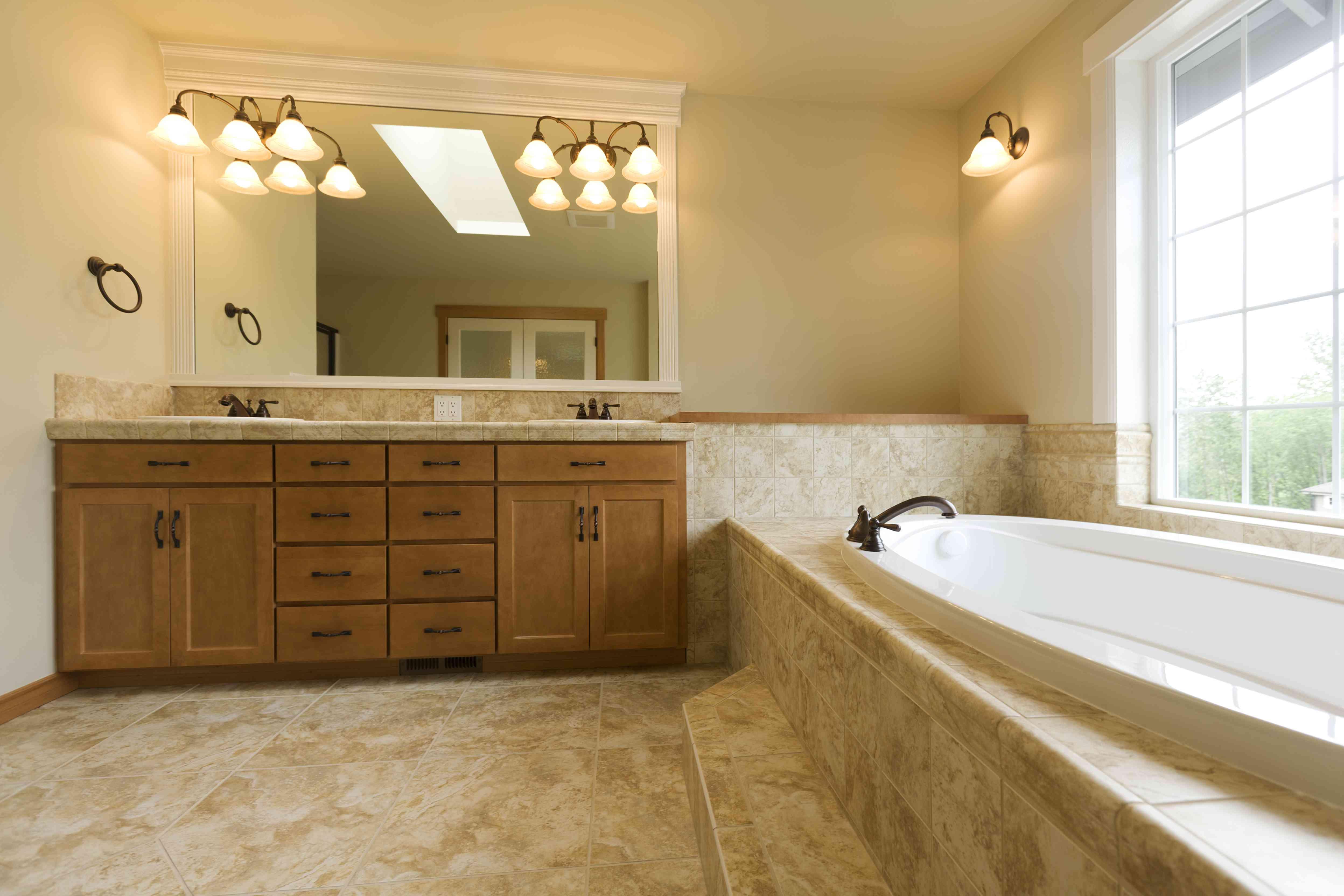 Luxury bathroom with travertine floors