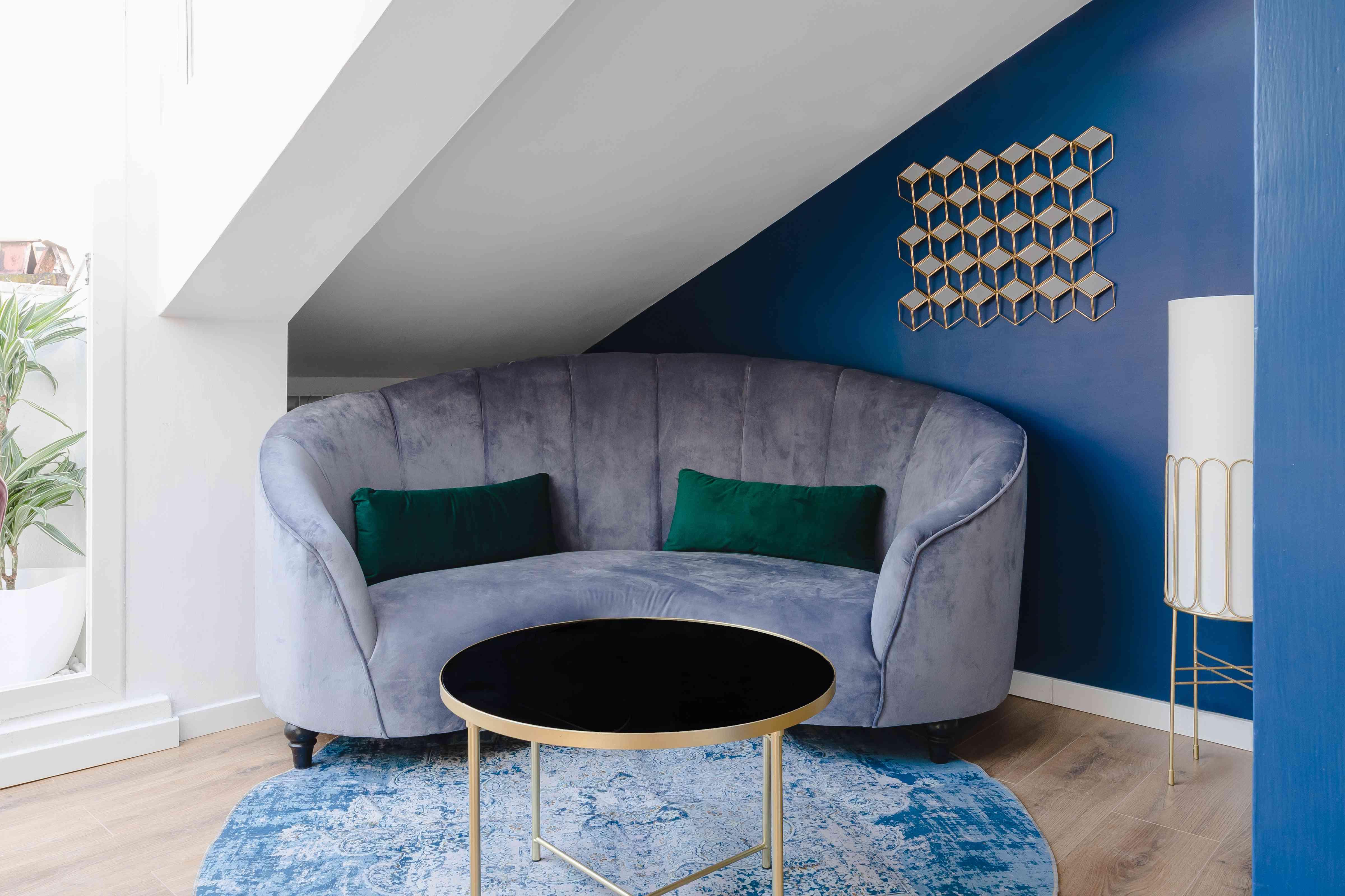 velvet sofa with gold-rimmed decor