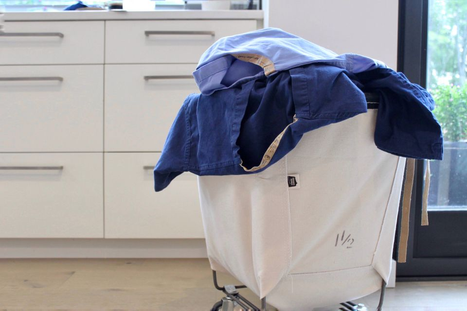 medical scrubs in the laundry basket