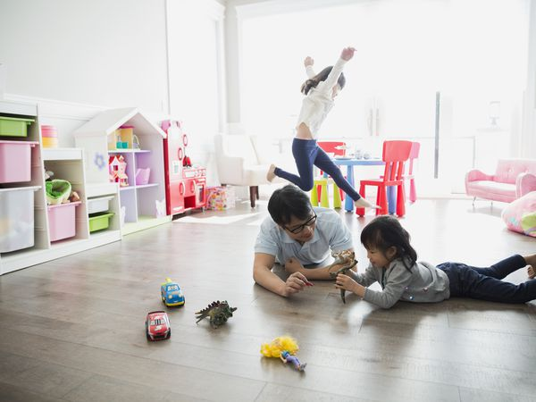 Grandfather and granddaughters playing in playroom