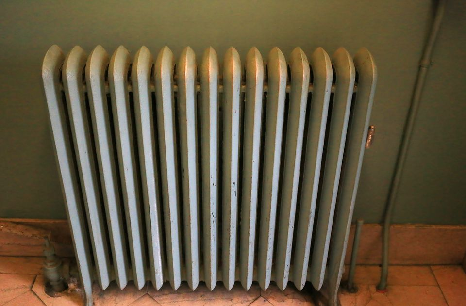 Old style cast iron household steam radiator for heat
