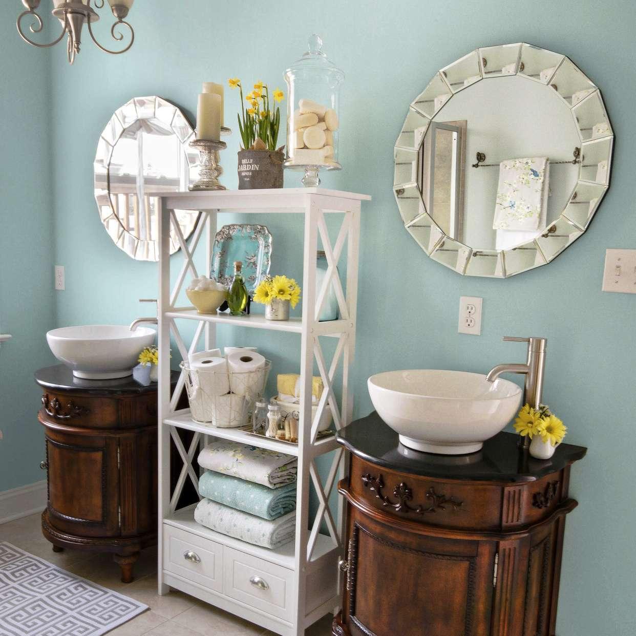 Blue bathroom with double vanities