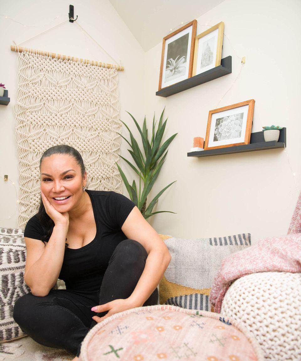 Egypt Sherrod poses in her meditation closet