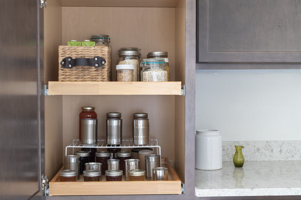 Kitchen pantry decluttered and organized with glass and metal containers
