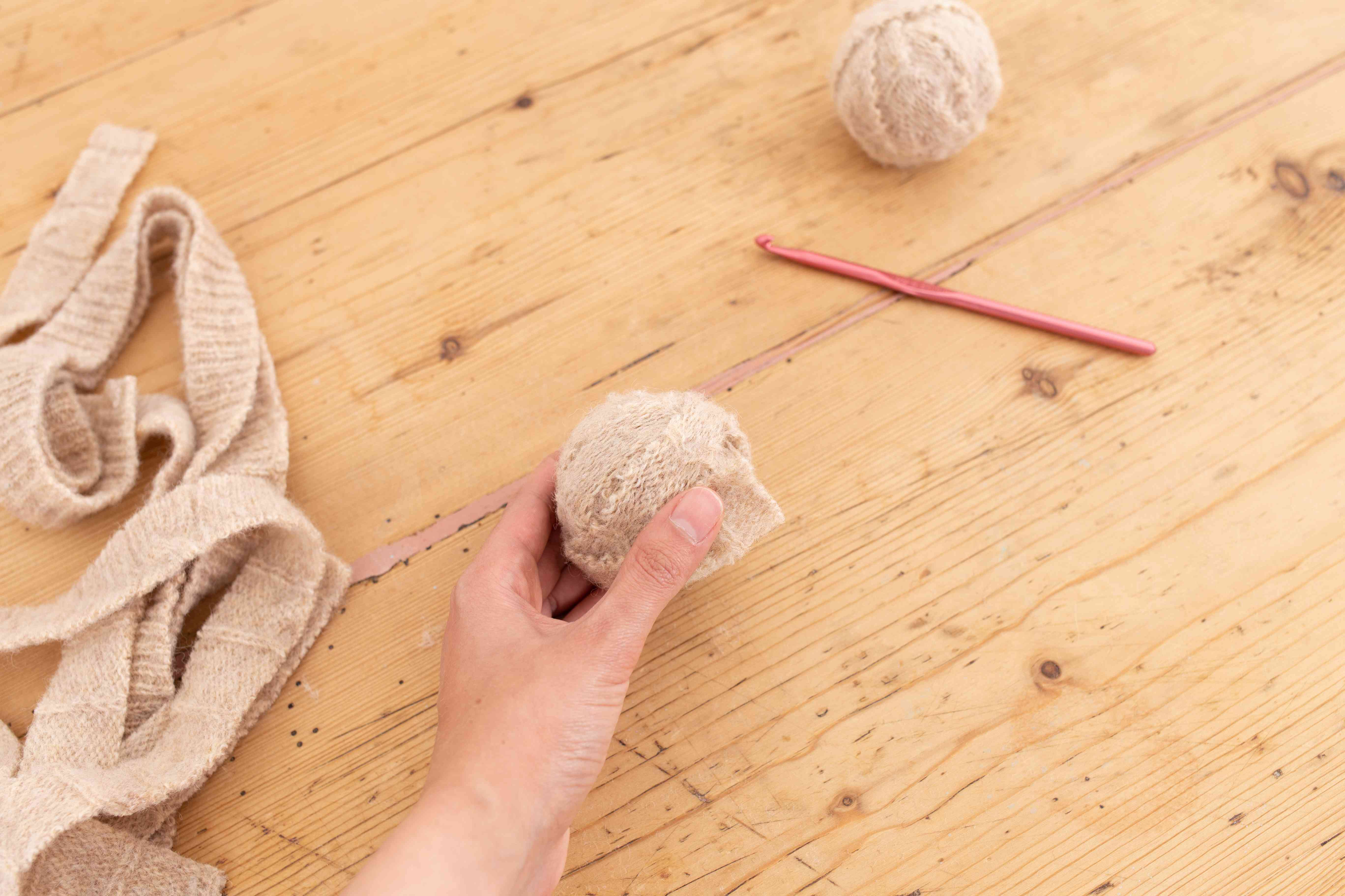 Fabric strips winding into tight ball with crochet hook