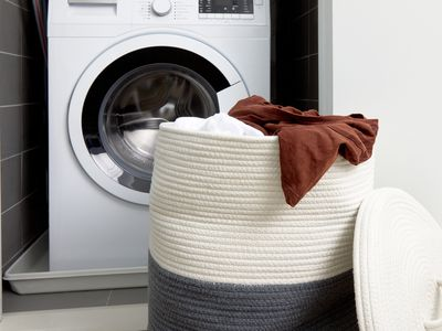 hamper in front of a washer