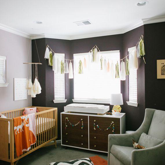 Modern black and orange nursery with midcentury style