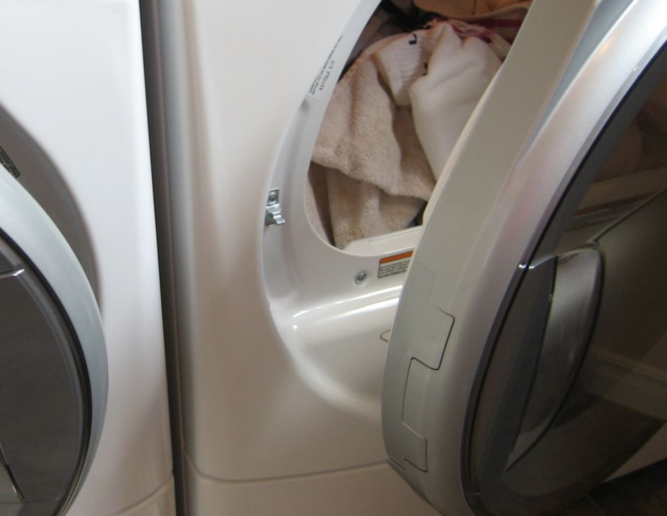 an open dryer with those inside