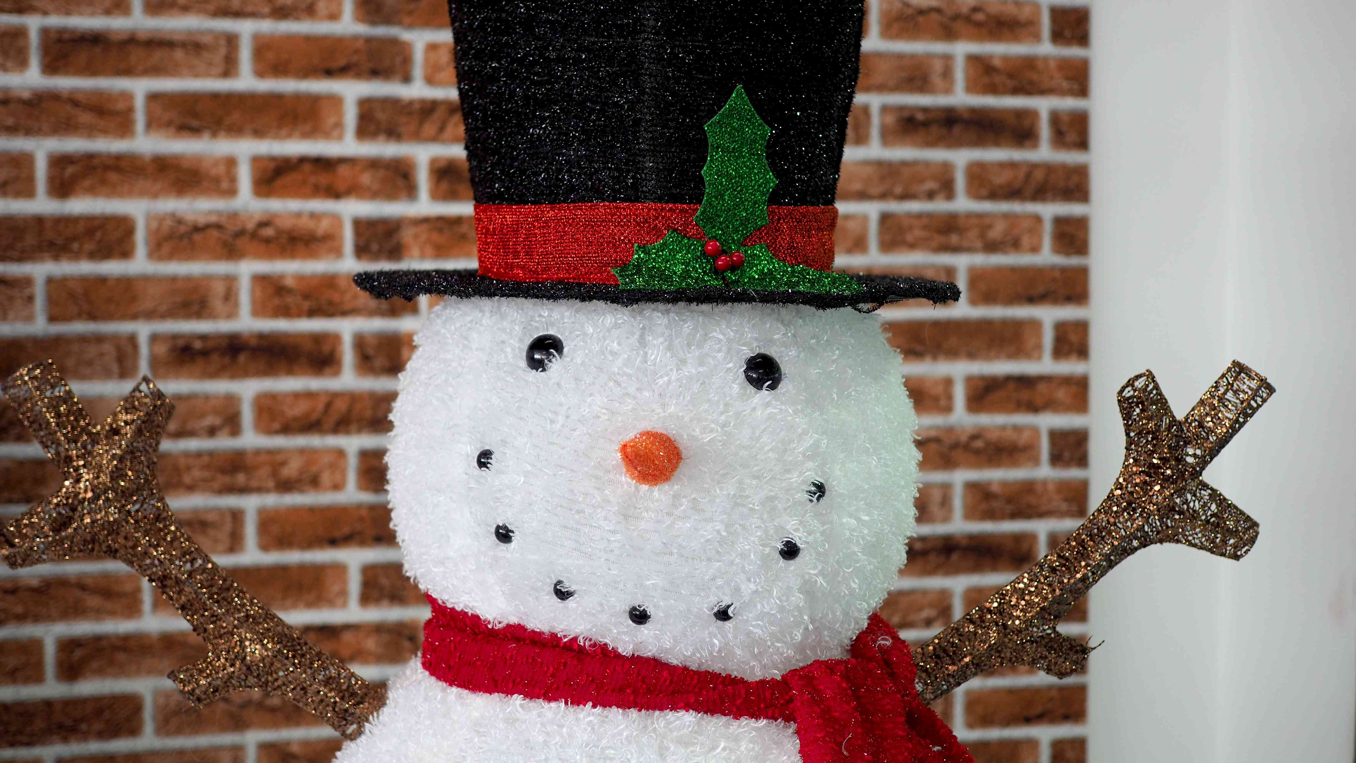 Closeup face of a snowman Christmas decoration in indoor area.