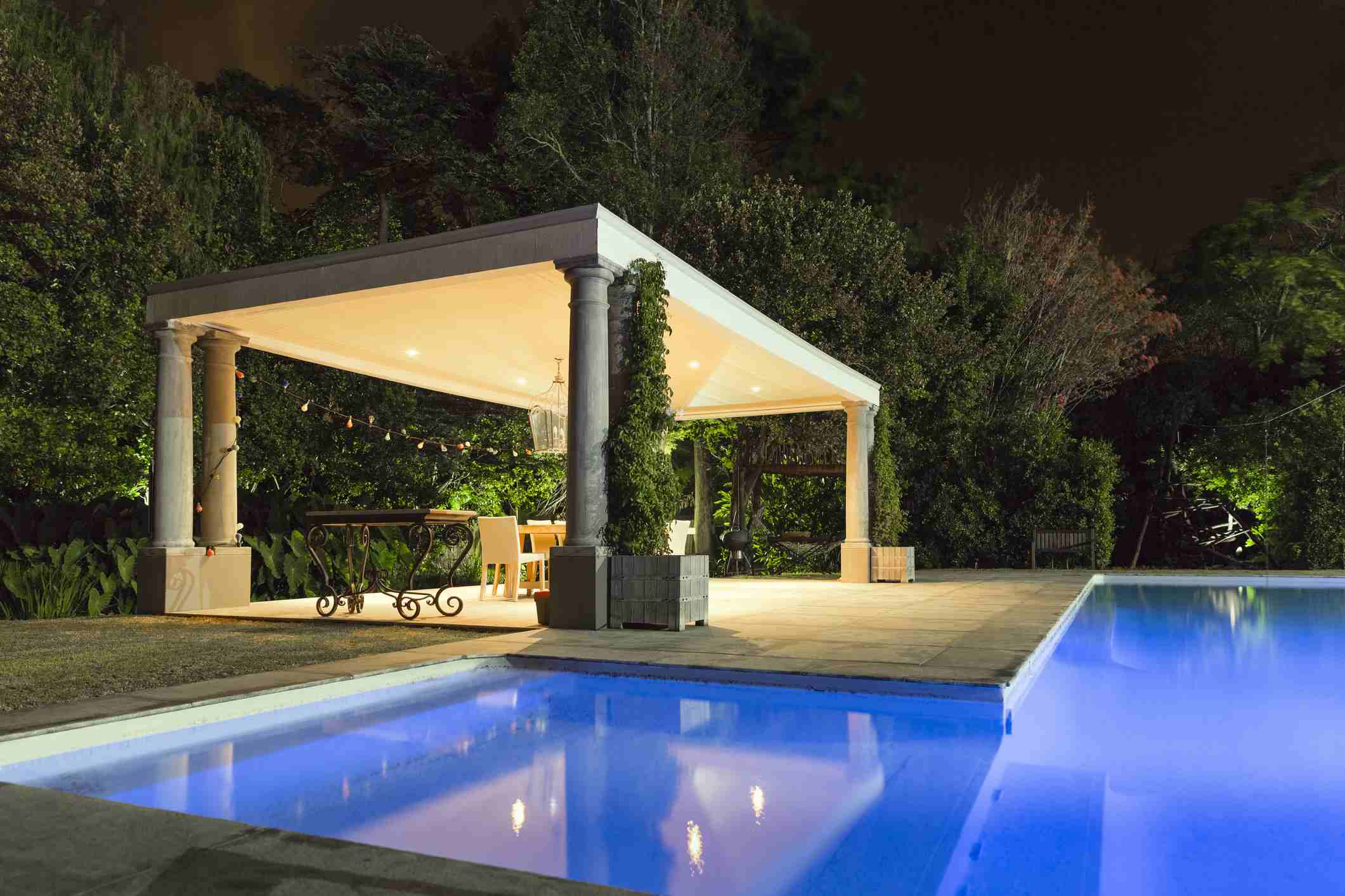 Patio with pool and pergola.