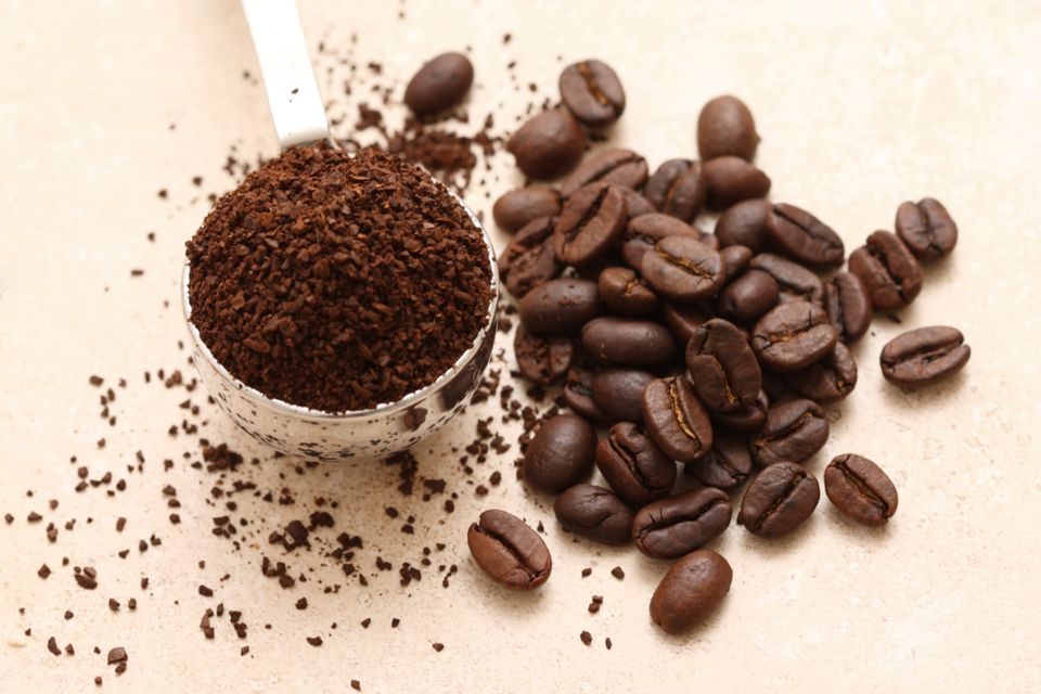 Fresh coffee grounds and coffee beans