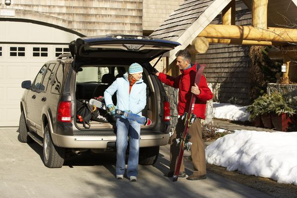 Couple loading car to go skiing