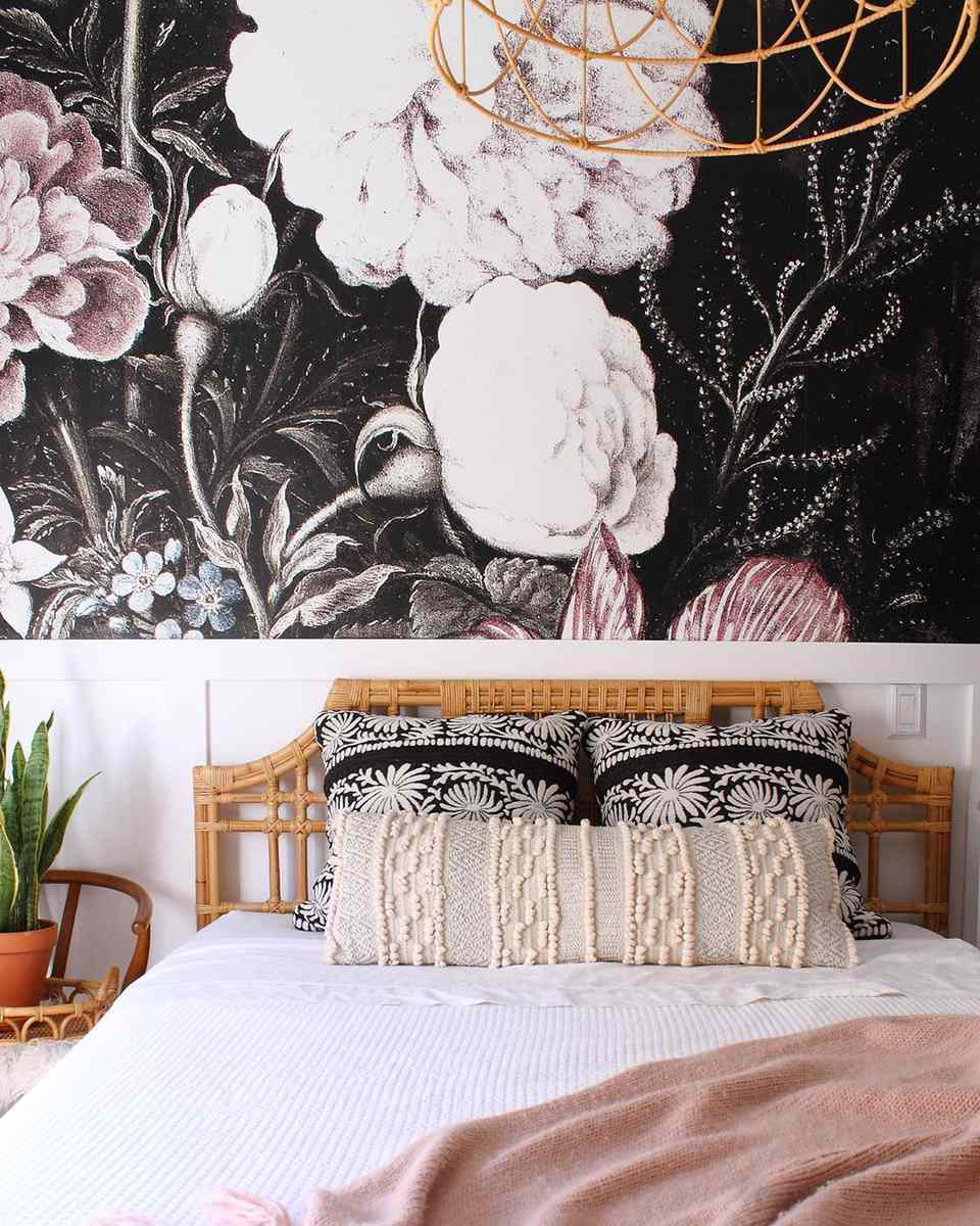 Guest room with vivid floral wallpaper