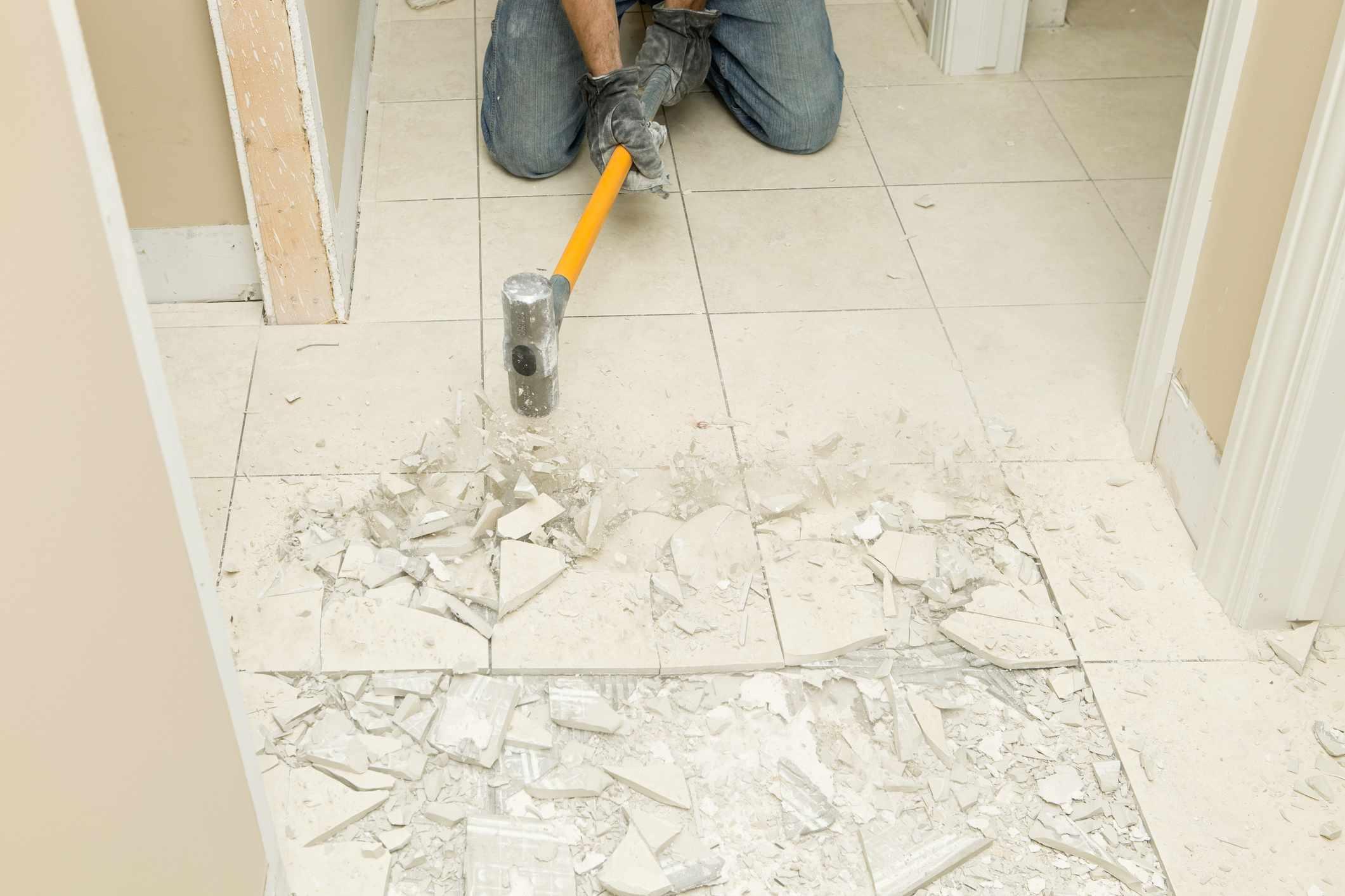 Breaking marble with sledgehammer