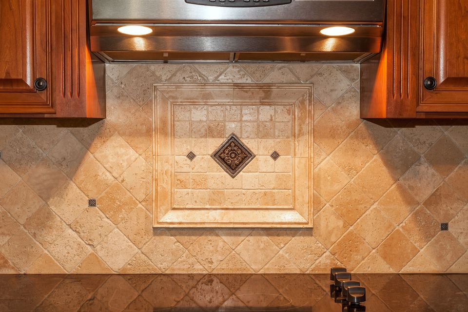 Traditional Kitchen with Travertine tile