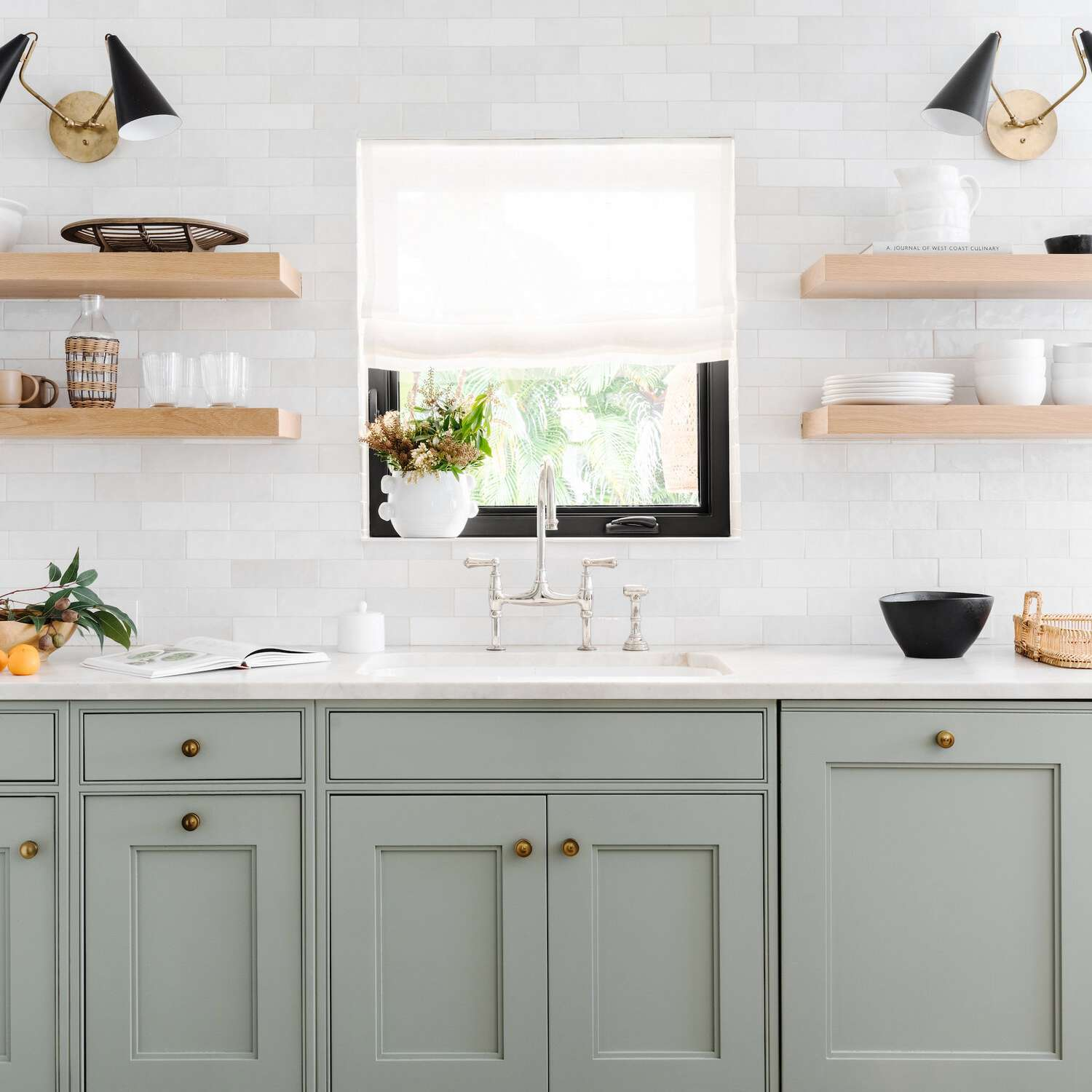 Kitchen with light green cabinets