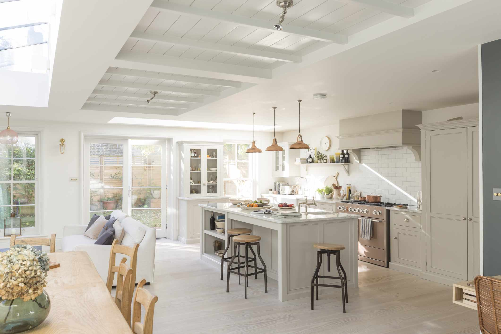 bright spacious white kitchen and dining table