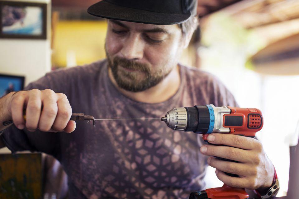 man adjusting drill bit