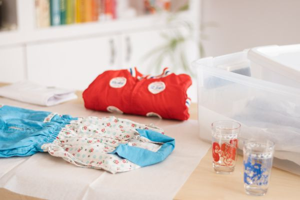 Baby clothes being folded for storage