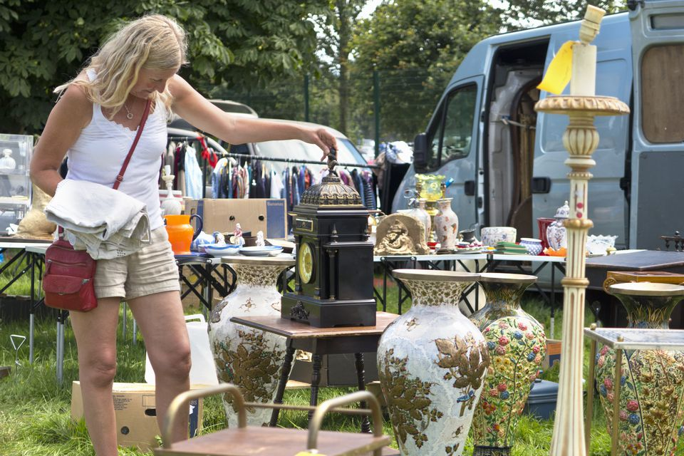 Woman browsing a stall at an outdoor flea market