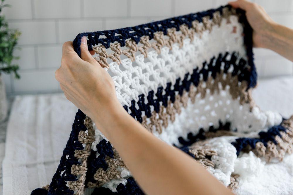 Someone holding a crochet blanket