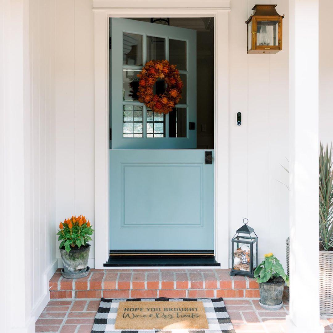 Blue barn door as a front door