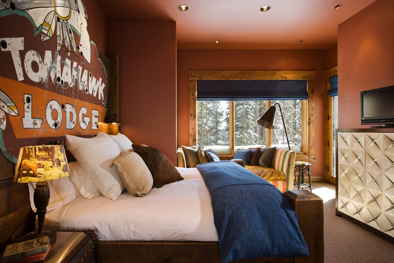 Dormitorio rústico nítido y fresco