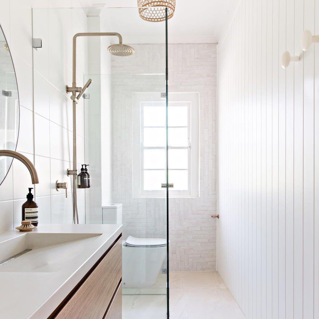White bathroom with a white concrete sink