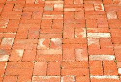 Photo of brick patio laid in basketweave pattern.