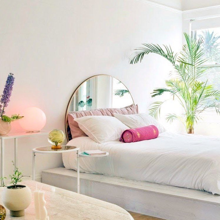 Bed with half mirror and palm plant