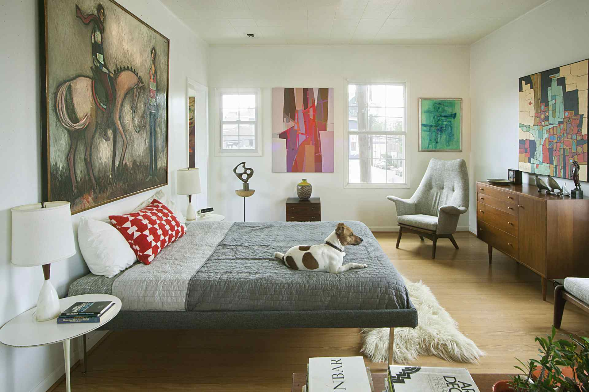 Midcentury modern bedroom with colorful artwork.
