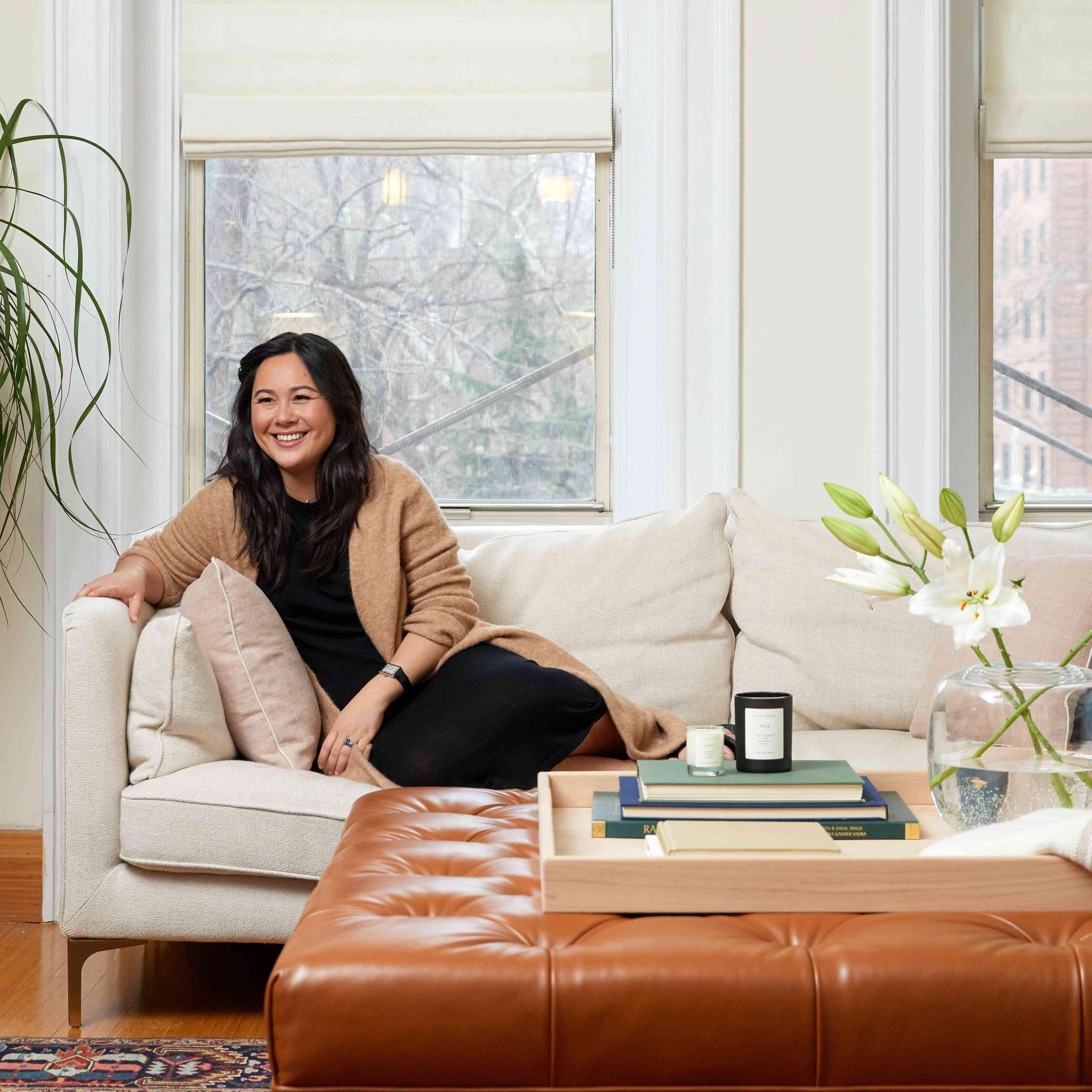 Davina Ogilvie poses on a white couch