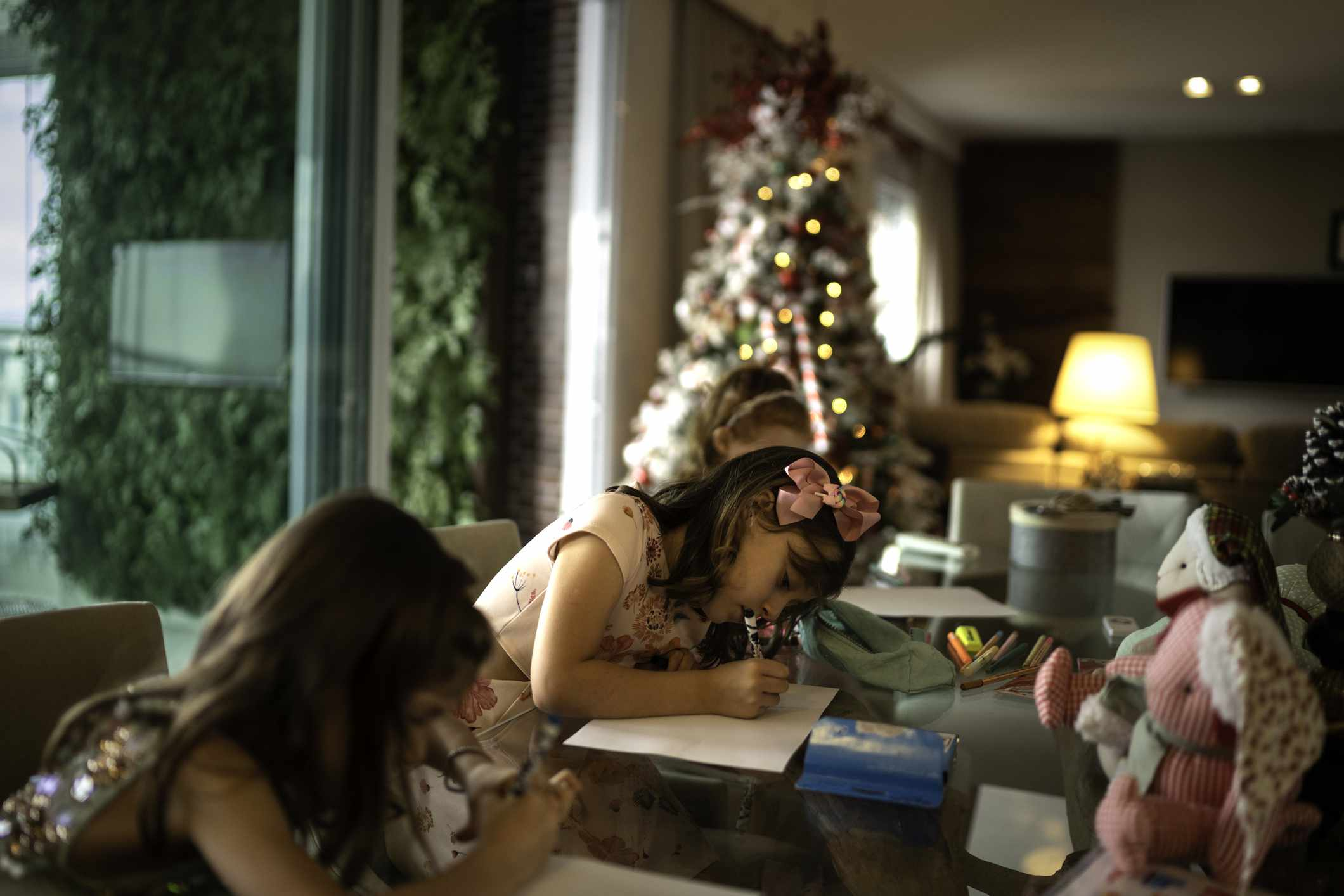 Small cute girls writing letter to Santa at home