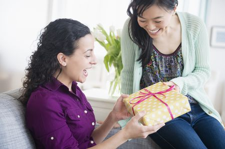 Woman Giving Friend Present
