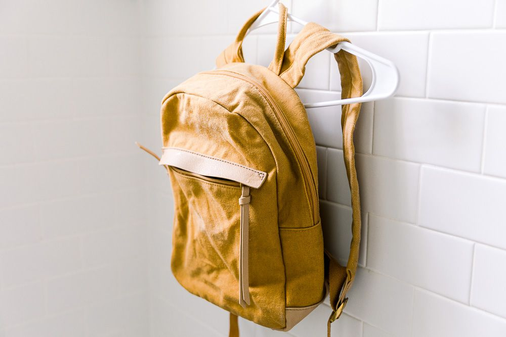 A yellow backpack on a hanger