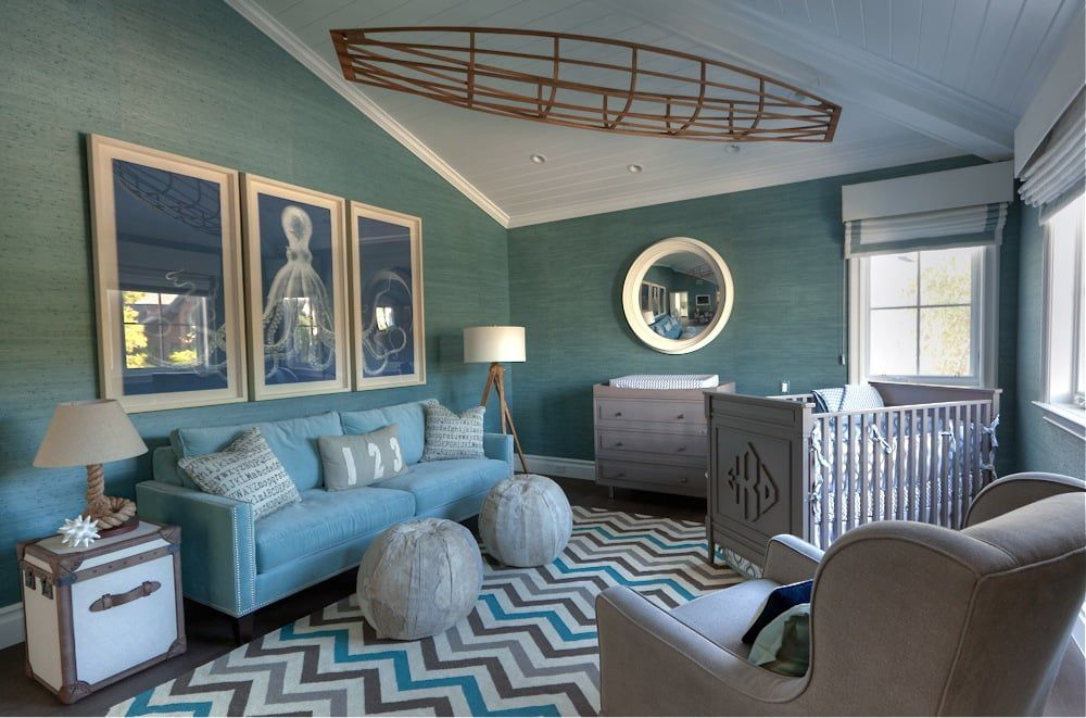 Teal and white nautical nursery with boat